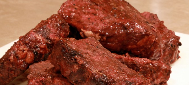 boneless barbecue ribs on cutting board