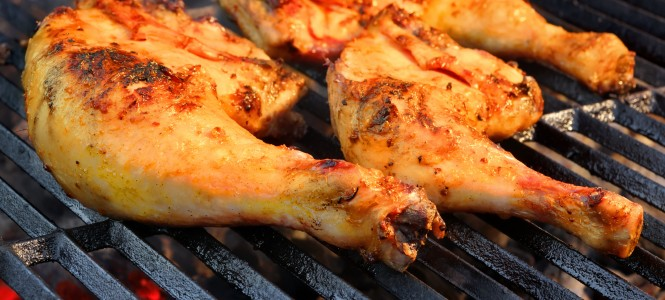 Marinated Chicken Legs On  The Hot BBQ Charcoal Grill. Good Snack For Outdoor Weekend Party or Picnic