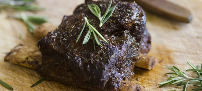 Delicious barbecue beef short ribs with rosemary